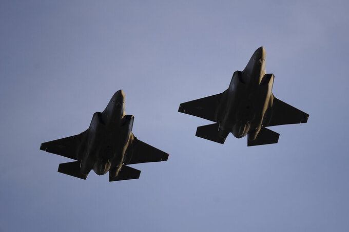 FILE - In this Nov. 1, 2018, file photo U.S. Air Force F-35 A-fighter jets from 31st Test Evaluation Squadron at Edwards AFB fly over Levi's Stadium before an NFL football game between the San Francisco 49ers and the Oakland Raiders in Santa Clara, Calif. Raytheon Co. and United Technologies Corp. are merging in a deal that creates one of the world's largest defense companies. The merger was announced Sunday, June 9, 2019. United Technologies makes engines for Lockheed Marti Corp.'s F-35 stealth fighter. (AP Photo/Ben Margot, File)
