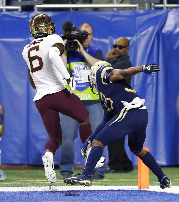 Minnesota wide receiver Tyler Johnson (6) runs out of bounds after scoring as Georgia Tech defensive back Jaytlin Askew defends during the first half of the Quick Lane Bowl NCAA college football game Wednesday, Dec. 26, 2018, in Detroit. (AP Photo/Carlos Osorio)