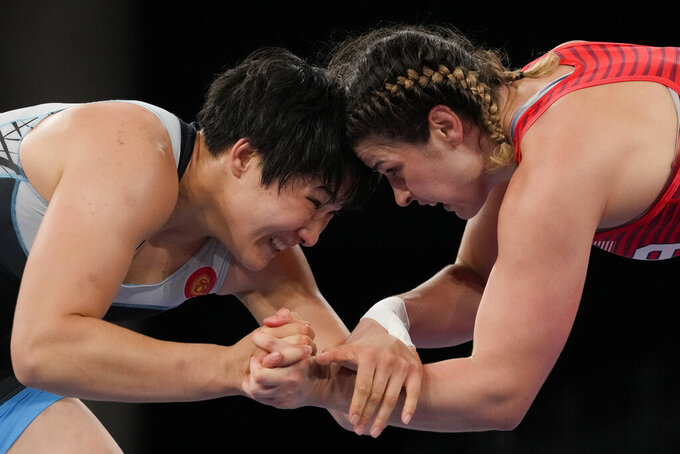 United States' Adeline Maria Gray, right, battles against Kyrgyzstan's Aiperi Medet Kyzy during the semi-final round of the women's 76kg freestyle wrestling match at the 2020 Summer Olympics, Sunday, Aug. 1, 2021 in Chiba, Japan. (AP Photo/Aaron Favila)
