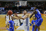 Kentucky forward Kevin Knox, center, gets around Buffalo forward Nick Perkins, right, for a shot during the second half of a second-round game in the NCAA men's college basketball tournament Saturday, March 17, 2018, in Boise, Idaho. Kentucky won 95-75. (AP Photo/Otto Kitsinger)