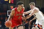 Arizona's Chase Jeter (4) drives around Oregon State's Zach Reichle (11) during the first half of an NCAA college basketball game in Corvallis, Ore., Thursday, Feb. 28, 2019. (AP Photo/Amanda Loman)