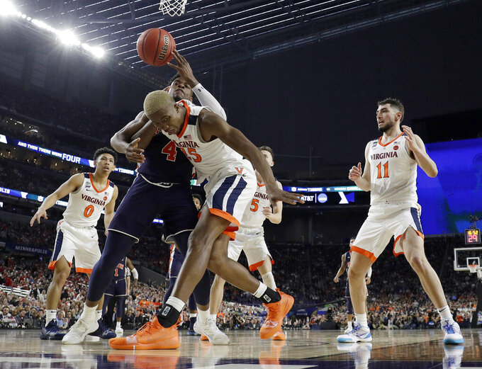 Auburn's Malik Dunbar (4) battles for a rebound against Virginia's Mamadi Diakite (25) during the second half in the semifinals of the Final Four NCAA college basketball tournament, Saturday, April 6, 2019, in Minneapolis. (AP Photo/Jeff Roberson)