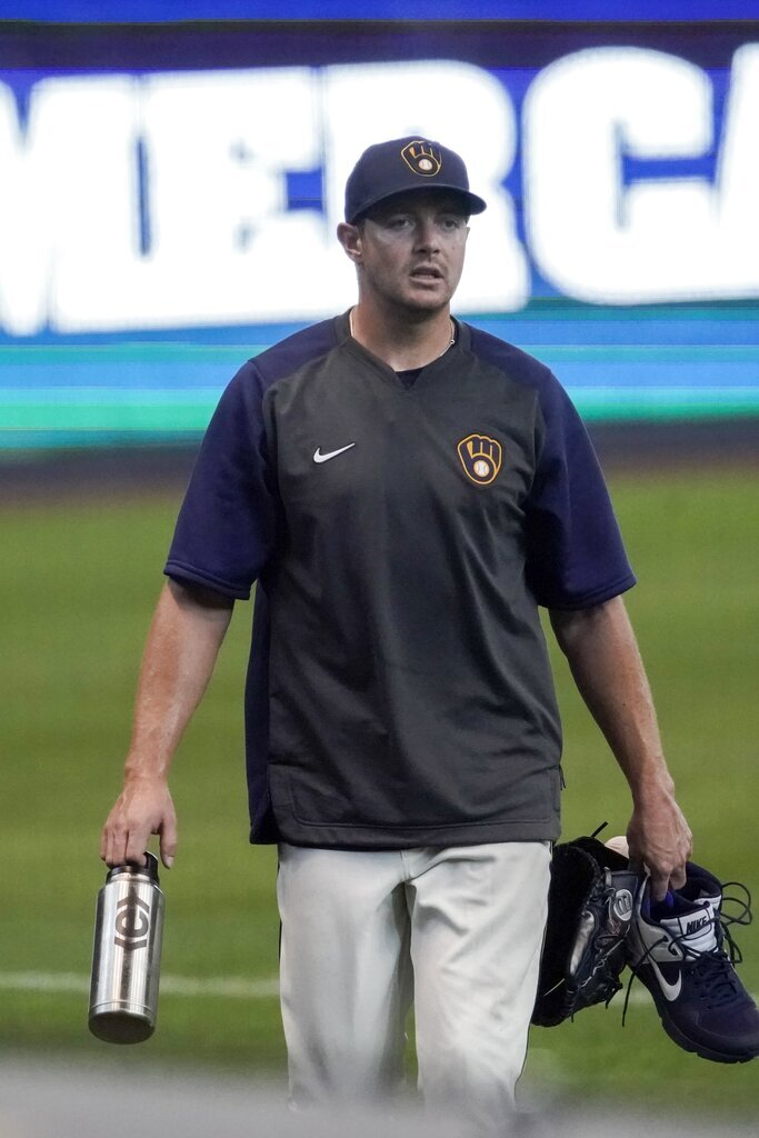 Milwaukee Brewers' Corey Knebel walks to the dugout during a practice session Monday, July 6, 2020, at Miller Park in Milwaukee. (AP Photo/Morry Gash)