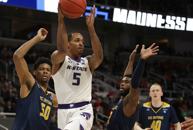 Kansas State guard Barry Brown Jr. (5) looks to pass against UC Irvine during the second half of a first-round game in the NCAA men's college basketball tournament Friday, March 22, 2019, in San Jose, Calif. (AP Photo/Ben Margot)