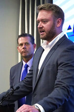 Oklahoma state Rep. Mickey Dollens, right, D-Oklahoma City, speaks during a news conference as state Rep. Kevin McDugle, left, R-Broken Arrow, looks on, Wednesday, June 16, 2021, in Oklahoma City. Thirty-four Oklahoma lawmakers, including 28 Republicans, are calling for reopening the investigation that led to the conviction of death row inmate Richard Glossip. (AP Photo/Sue Ogrocki)