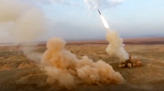 This frame grab from video shows the launching of underground ballistic missiles by the Iranian Revolutionary Guard during a military exercise. Iran's paramilitary guard launched underground ballistic missiles as part of an exercise involving a mock-up aircraft carrier in the Strait of Hormuz, state television reported Wednesday. (Sepahnews via AP)