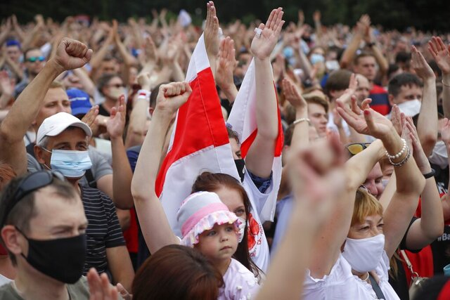 Belarusians attend a meeting in support of Svetlana Tikhanovskaya, candidate for the presidential election, in Minsk, Belarus, Sunday July 19, 2020. The presidential election in Belarus is scheduled for August 9, 2020. (AP Photo/Sergei Grits)