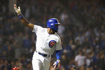 Chicago Cubs' Jason Heyward watches his RBI-double during the sixth inning of a baseball game against the Cincinnati Reds, Monday, Sept. 16, 2019, in Chicago. Willson Contreras scored on the play. (AP Photo/Charles Rex Arbogast)