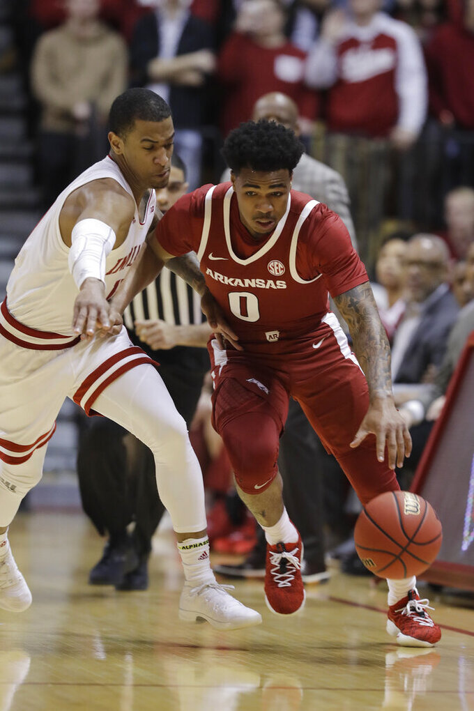 Arkansas's Desi Sills (0) is defended by Indiana's Devonte Green (11) during the first half in the second round of the NIT college basketball tournament, Saturday, March 23, 2019, in Bloomington, Ind. (AP Photo/Darron Cummings)