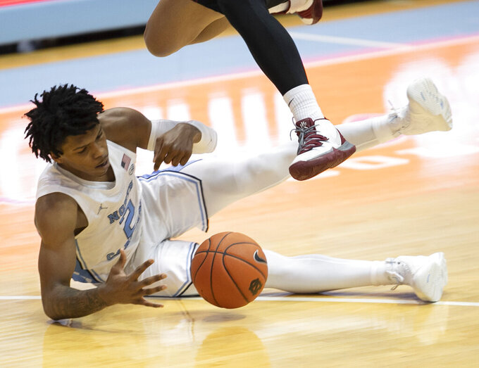 North Carolina's Caleb Love (2) make a steal from North Carolina Central's C.J. Keyser (22) during the second half of an NCAA college basketball game, Saturday, Dec. 12, 2020, at the Smith Center in Chapel Hill, N.C. (Robert Willett/The News & Observer via AP)