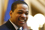 Virginia Lt. Gov Justin Fairfax smiles during the senate session at the Capitol in Richmond, Va., Thursday, Feb. 7, 2019. A California woman has accused Fairfax of sexually assaulting her 15 years ago. (AP Photo/Steve Helber)
