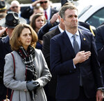 Virginia Gov. Ralph Northam, right, and his wife Pam, watch as the casket of fallen Virginia State Trooper Lucas B. Dowell is carried to a waiting tactical vehicle during the funeral at the Chilhowie Christian Church in Chilhowie, Va., Saturday, Feb. 9, 2019. Dowell was killed in the line of duty earlier in the week. (AP Photo/Steve Helber, Pool)