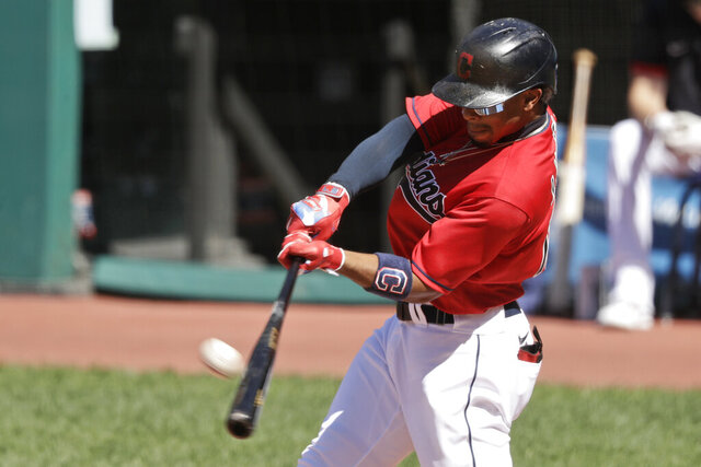 Cleveland Indians' Francisco Lindor hits a two run home run in the first inning in the first baseball game of a doubleheader against the Chicago White Sox, Tuesday, July 28, 2020, in Cleveland. (AP Photo/Tony Dejak)
