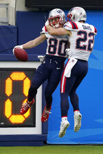New England Patriots wide receiver Gunner Olszewski (80) celebrates his punt return for a touchdown with Cody Davis (22) during the first half of an NFL football game against the Los Angeles Chargers Sunday, Dec. 6, 2020, in Inglewood, Calif. (AP Photo/Ashley Landis)