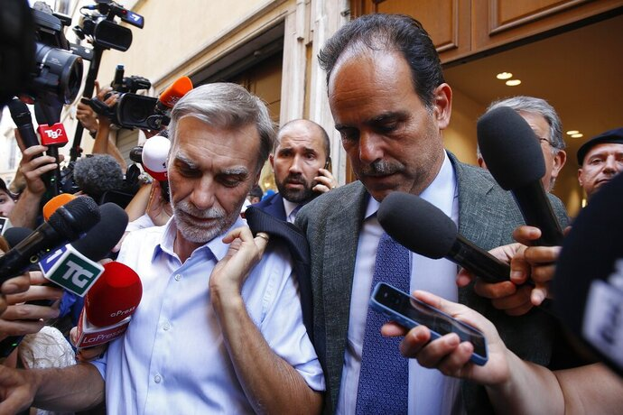 Democratic Party whips Graziano Delrio, left, and Andrea Marcucci leave the headquarters of the party to meet the 5-Star Movement delegation on government talks, in Rome, Tuesday, Aug. 27, 2019. (Fabio Frustaci/ANSA via AP)