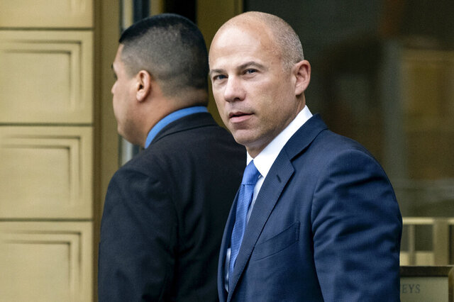 FILE - In this July 23, 2019, file photo, California attorney Michael Avenatti walks from a courthouse in New York, after facing charges. Avenatti, a lawyer who gained fame by representing a porn star in lawsuits against President Donald Trump, has been convicted Friday, Feb. 14, 2020, of trying to extort the apparel company Nike. The charges carry a combined potential penalty of 42 years in prison. (AP Photo/Craig Ruttle, File)