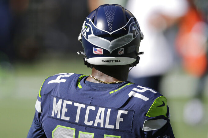 "Seattle Seahawks wide receiver DK Metcalf wears ""Emmett Till"" on his helmet in support of Black Lives Matter before an NFL football game against the Dallas Cowboys, Sunday, Sept. 27, 2020, in Seattle. (AP Photo/John Froschauer)"