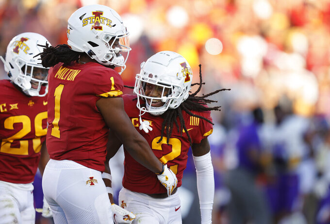 Iowa State defensive back Datrone Young (2) celebrates his interception with wide receiver Tarique Milton (1) during the second half of an NCAA college football game, Saturday, Sept. 4, 2021, in Ames, Iowa. Iowa State won 16-10. (AP Photo/Matthew Putney)