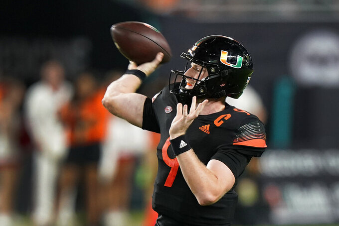 Miami quarterback Tyler Van Dyke throws a pass during the first half of the team's NCAA college football game against North Carolina State, Saturday, Oct. 23, 2021, in Miami Gardens, Fla. (AP Photo/Wilfredo Lee)