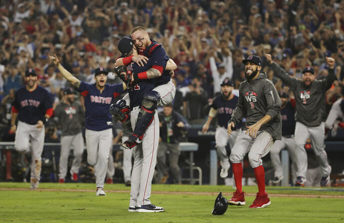 FILE - In this Oct. 28, 2018, file photo, the Boston Red Sox celebrate after Game 5 of baseball's World Series against the Los Angeles Dodgers, in Los Angeles. The goal is the same for the Red Sox in 2019: finish the season flopping around on the pitcher's mound, celebrating another World Series title. (AP Photo/Jae C. Hong, File)