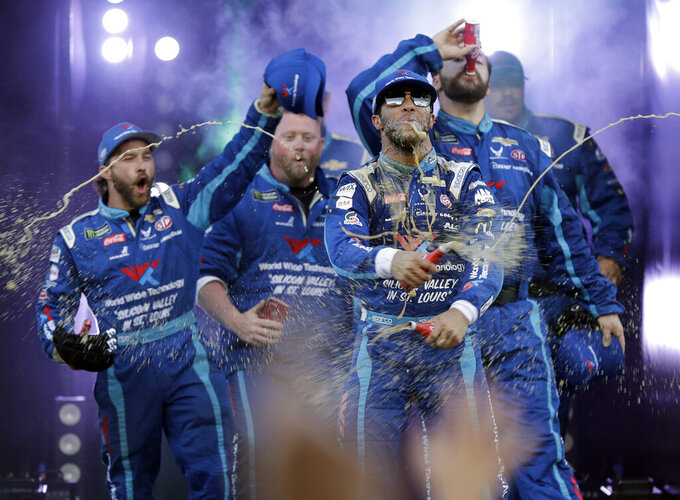Bubba Wallace, front, celebrates with team members as he is introduced for the NASCAR All-StarRace at Charlotte Motor Speedway in Concord, N.C., Saturday, May 18, 2019. (AP Photo/Chuck Burton)