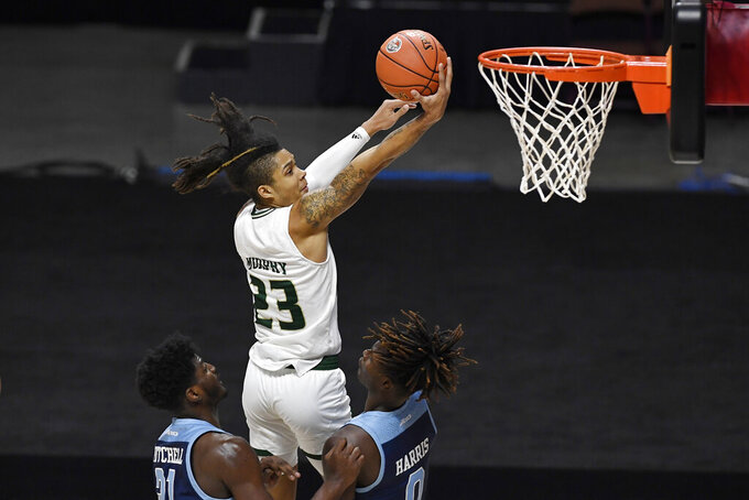 South Florida's Caleb Murphy, top, goes up for a basket against Rhode Island's Makhi Mitchell, left, and Jermaine Harris, right, in the second half of an NCAA college basketball game, Saturday, Nov. 28, 2020, in Uncasville, Conn. (AP Photo/Jessica Hill)