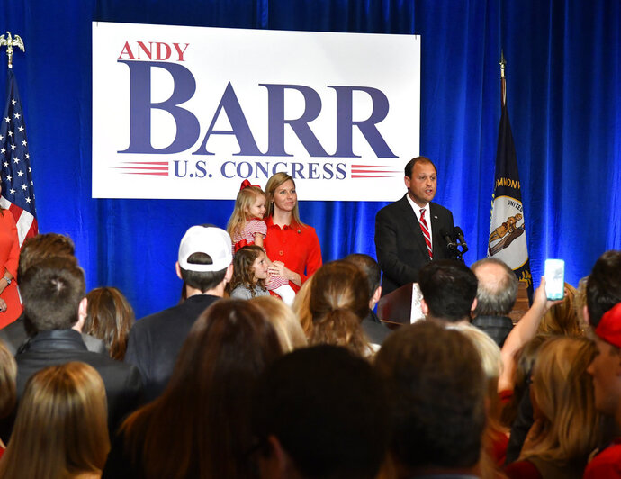 Rep. Andy Barr, R-Ky., right, with his wife Carol and daughters Eleanor and Mary Clay thank his his supporters during his victory celebration in Lexington, Ky., Tuesday, Nov. 6, 2018. (AP Photo/Timothy D. Easley)
