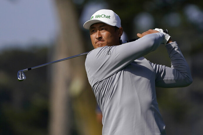 Li Haotong of China, hits from the fairway on the 10th hole during the second round of the PGA Championship golf tournament at TPC Harding Park Friday, Aug. 7, 2020, in San Francisco. (AP Photo/Charlie Riedel)