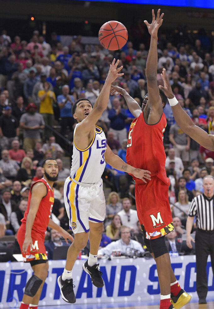 LSU guard Tremont Waters (3) makes the game-winning shot as Maryland's Jalen Smith (25) defends during the second half in a second-round game in the NCAA men's college basketball tournament in Jacksonville, Fla., Saturday, March 23, 2019. (Will Dickey/The Florida Times-Union via AP)