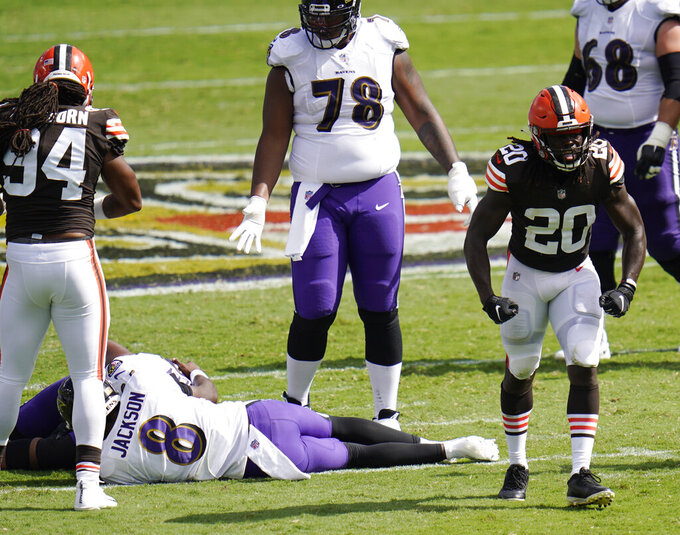 Cleveland Browns cornerback Tavierre Thomas (20) reacts after sacking Baltimore Ravens quarterback Lamar Jackson (8), during the second half of an NFL football game, Sunday, Sept. 13, 2020, in Baltimore, MD. (AP Photo/Julio Cortez)