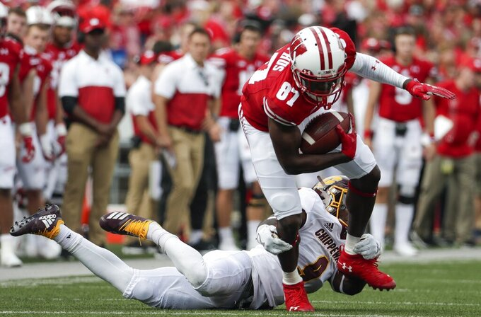 Wisconsin's Quintez Cephus tries to get away from Central Michigan's Brandon Brown during the first half of an NCAA college football game Saturday, Sept. 7, 2019, in Madison, Wis. (AP Photo/Morry Gash)