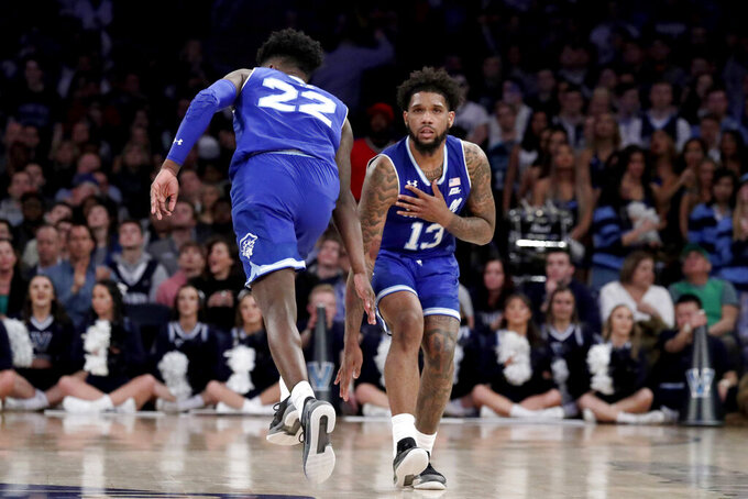 Seton Hall guard Myles Cale (22) and guard Myles Powell (13) react after Cale scored a basket on Villanova during the second half of an NCAA college basketball game in the championship of the Big East Conference tournament, Saturday, March 16, 2019, in New York. Villanova won 74-72. (AP Photo/Julio Cortez)