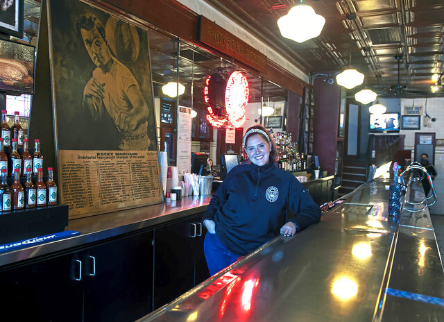 Jen Grippo, owner of the Original Oyster House, poses for a portrait Wednesday, Oct. 7, 2020, in  in Pittsburgh. The iconic restaurant celebrated its 150th anniversary on Monday, Oct. 12. (Pittsburgh Post-Gazette via AP)