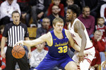 South Dakota State's Matt Dentlinger (32) is defended by Indiana's De'Ron Davis, right, during the first half of an NCAA college basketball game, Saturday, Nov. 30, 2019, in Bloomington, Ind. (AP Photo/Darron Cummings)