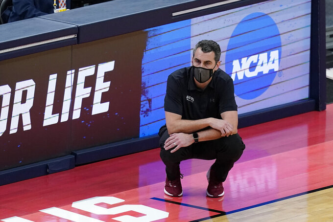 Colgate head coach Matt Langel watches during the second half of a first round game against Arkansas at Bankers Life Fieldhouse in the NCAA men's college basketball tournament, Friday, March 19, 2021, in Indianapolis. (AP Photo/Darron Cummings)