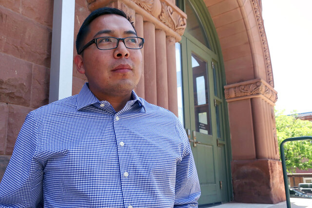 FILE - In this June 28, 2019, file photo, Tremayne Nez stands outside the Coconino County courthouse in Flagstaff, Ariz. Nez, a Flagstaff man who was wrongfully arrested on suspicion of selling LSD has reached a settlement with the city. The settlement finalized Monday, Jan. 11, 2021, comes nearly seven months after Nez, who is Navajo, filed a federal lawsuit accusing Flagstaff police of ignoring evidence that showed he wasn't a drug dealer. (AP Photo/Felicia Fonseca, File)