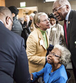 FILE - In this Nov. 23, 2015, file photo, Emily Clyburn, bottom, and her husband, U.S. Rep. James Clyburn, top right,  talk to people at the University of South Carolina in Columbia, S.C. Emily Clyburn, the wife of House Majority Whip Jim Clyburn of South Carolina who helped raise millions of dollars to help students attend the alma mater they shared, died in Columbia on Thursday morning, Sept. 19, 2019. according to the congressman's office. She was 80. (AP Photo/Sean Rayford, File)