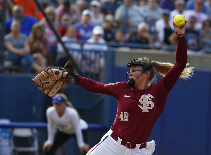 Florida State starting pitcher/relief pitcher Meghan King (48) pitches in the first game of the best-of-three championship series in the NCAA Women's College World Series in Oklahoma City, Monday, June 4, 2018. King is an American with Puerto Rican ties who will help the unincorporated U.S. territory try to qualify for the 2020 Olympics in Tokyo. (AP Photo/Sue Ogrocki, File)