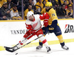 Detroit Red Wings center Luke Glendening (41) is defended by Nashville Predators' P.K. Subban (76) during the first period of an NHL hockey game Tuesday, Feb. 12, 2019, in Nashville, Tenn. (AP Photo/Mark Humphrey)