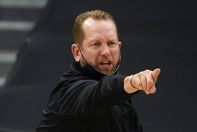Toronto Raptors head coach Nick Nurse calls a play during the second half of an NBA basketball game against the Washington Wizards Thursday, May 6, 2021, in Tampa, Fla. (AP Photo/Chris O'Meara)