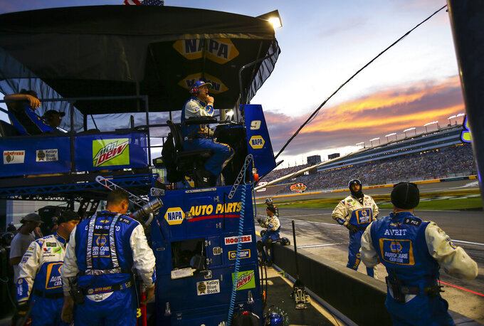 Chase Elliott's pit crew monitors the action during a NASCAR Cup Series auto race at the Las Vegas Motor Speedway on Sunday, Sept. 15, 2019. (AP Photo/Chase Stevens)
