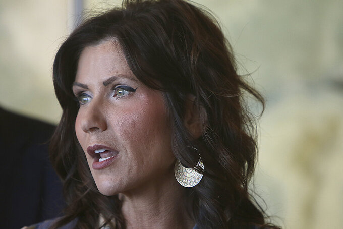 FILE - In this Wednesday, March 18, 2020, file photo, South Dakota Gov. Kristi Noem speaks in Rapid City, S.D. Noem on Thursday, April, 2, 2020, said she was activating the National Guard to set up temporary hospitals in Sioux Falls and Rapid City. (Jeff Easton/Rapid City Journal via AP, File)