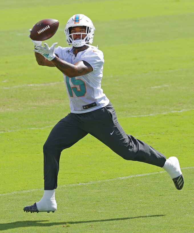 Miami Dolphins wide receiver Lynn Bowden Jr. (15) catches the ball during NFL football practice in Davie, Fla., Friday, Sept. 11, 2020. (AP Photo/Joel Auerbach)