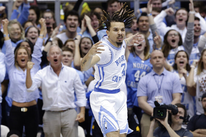 North Carolina guard Cole Anthony (2) reacts following a basket against North Carolina State during the second half of an NCAA college basketball game in Chapel Hill, N.C., Tuesday, Feb. 25, 2020. (AP Photo/Gerry Broome)