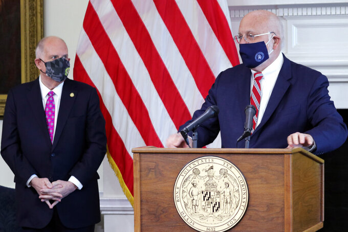 Dr. Robert Redfield, the former director of the U.S. Centers for Disease Control and Prevention, speaks at a news conference on Tuesday, March 2, 2021, in Annapolis, Md., after Gov. Larry Hogan, standing left, announced he would be a senior adviser for public health and advise Maryland officials on the state's COVID-19 vaccine campaign and response to variants. (AP Photo/Brian Witte)