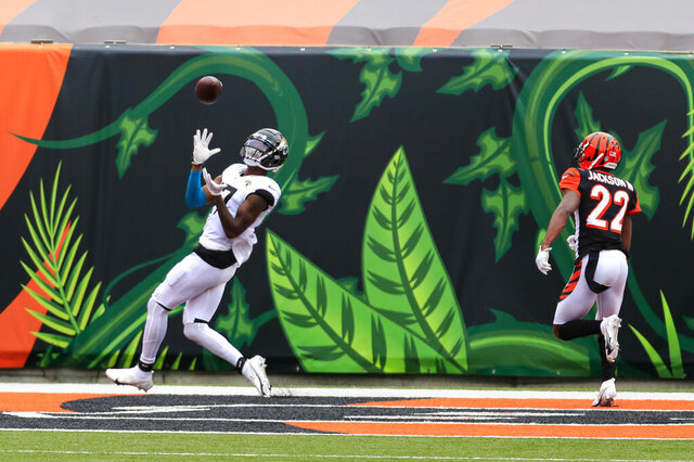 Jacksonville Jaguars wide receiver D.J. Chark (17) makes a catch for a touchdown in front of Cincinnati Bengals cornerback William Jackson (22) in the first half of an NFL football game in Cincinnati, Sunday, Oct. 4, 2020. (AP Photo/Aaron Doster)