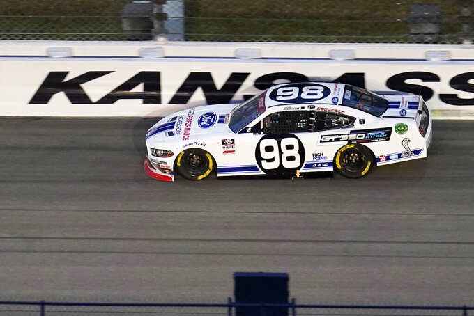 Chase Briscoe (98) leads a lap during a NASCAR Xfinity Series auto race at Kansas Speedway in Kansas City, Kan., Saturday, Oct. 17, 2020. Briscoe was the first stage winner in the race. (AP Photo/Orlin Wagner)