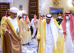 In this photo released by Saudi Royal Palace, Saudi King Salman, third right, welcomes Omani Sultan Haitham bin Tariq, at Neom Royal Palace, in the Tabuk Province of northwestern Saudi Arabia, Sunday, July 11, 2021. Sultan Haitham started the first visit by an Omani ruler in years against the backdrop of renewed diplomatic efforts to end the war in Yemen and the sultanate's worsening economic woes. (Bandar Aljaloud/Saudi Royal Palace via AP)