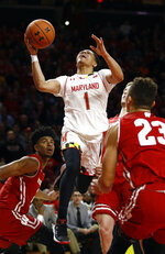 Maryland guard Anthony Cowan Jr. (1) shoots over Wisconsin forward Aleem Ford, left, and guard Kobe King in the second half of an NCAA college basketball game, Monday, Jan. 14, 2019, in College Park, Md. Cowan contributed a game-high 21 points to Maryland's 64-60 win. (AP Photo/Patrick Semansky)