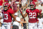 Alabama quarterback Tua Tagovailoa (13) and running back Najee Harris (22) look back to the sideline for a play during the first half of an NCAA college football game against New Mexico State, Saturday, Sept. 7, 2019, in Tuscaloosa, Ala. (AP Photo/Vasha Hunt)